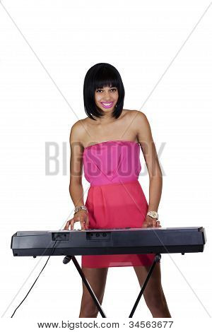 Young African American Standing At Electronic Piano