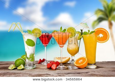 Summer cocktails with blur beach on background