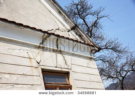 serious damage to the building of a house gable. unsafe building.