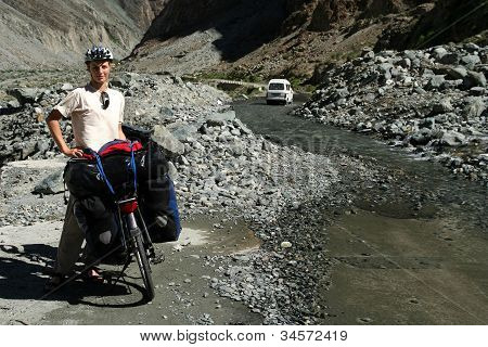 Cyclist taking a break on Karakorum Highway