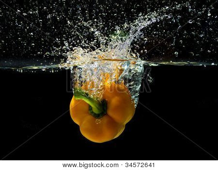 Sweet yellow pepper, splashing in water
