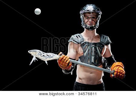 Boys lacrosse player catching a ball