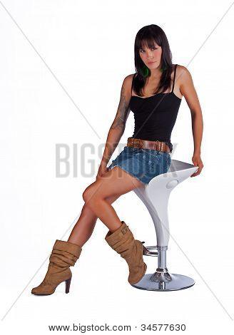 Beautiful woman sitting on a stool