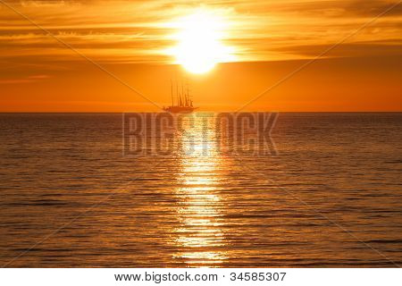 Old Tall Sail Ship Silhouette In Sunset