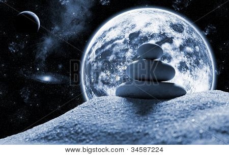 Macro of three staked zen stones in space against planet