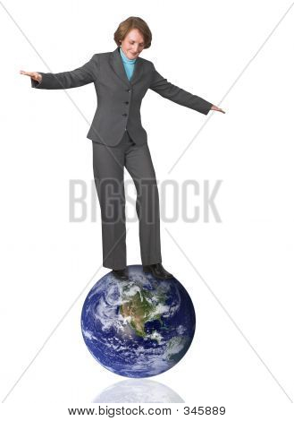 Business Woman Balancing On Earth