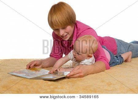 Mother And Baby Looking At A Book