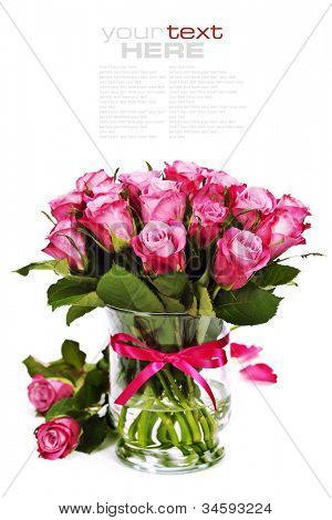 bouquet of pink roses in vase (with easy removable sample text)