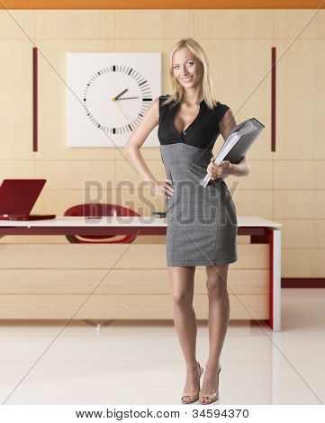 Smiling Blonde Business Woman In Full-lengh