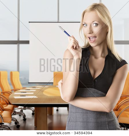 Blonde Business Woman Tkes Pen