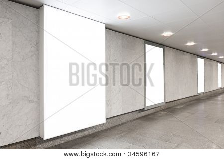 Blank billboards located in underground hall useful for your advertising