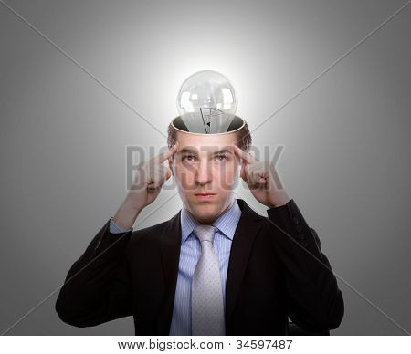 Portrait of young business man thinking with light bulb out from head