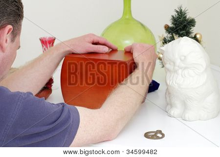 Man Holding A Wood Urn