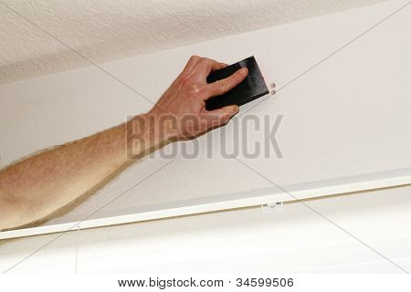 Sanding Down Hole In Wall