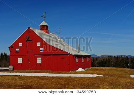 A newer bright red barn