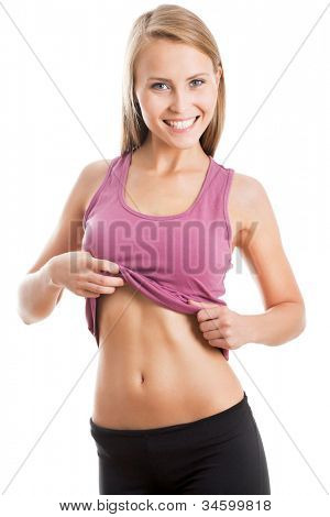 Happy fitness woman shows her belly