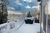 Home Outdoor Deck Closed For The Winter Season With Snow On Bbq Cooker Cover poster