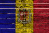 National Flag  Of Andorra On A Wooden Wall Background. The Concept Of National Pride And A Symbol Of poster