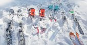 Splitboards And Skis On White Snow. Sport Equipment For Ski Touring poster