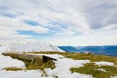 Picturesque Mountain View With Wooden Bench For Weary Hikers. poster