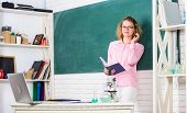 Girl Adorable Teacher In Classroom. Educational Process Concept. Educational Program For Primary Sch poster