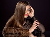 Woman with beauty long brown hair. Fashion model with long straight hair. Fashion model with a smoke poster