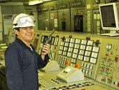 stock photo of lng  - A shipping engineer near a panel of ship - JPG
