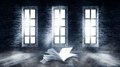 Open Book Magic. Dark Background Magic. An Open Book On A Wooden Table Under The Night Sky Against A poster