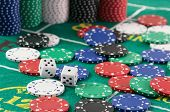 picture of crap  - Craps table with casino chips and dice - JPG
