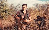 Man With Rifle Hunting Equipment Nature Background. Prepare For Hunting. What You Should Have While  poster