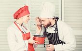 Woman And Bearded Man Cooking Together. Try Ingredients Before Cook. Estimate Taste. Healthy Food. J poster