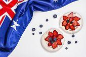 Australia Day. Australia National Day Background With Australia National Flag, Dessert Pavlova Cakes poster