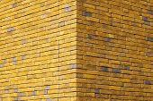 Yellow Brick Texture Of The Corner Of The House. Yellow Brick Wall For Background Or Texture. Old Ye poster