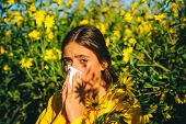 Attractive Woman Outdoor With Tissue Having Allergy. Pollen Allergy Concept. Amazing Woman In The Pa poster