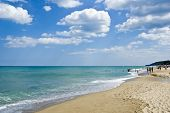 stock photo of sunny beach  - Summer beach scene at the Bulgarian town of Obzor - JPG