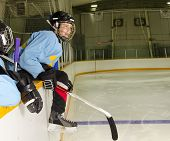 stock photo of hockey arena  - A Hockey Player on the Bench at the Rink is Ready to Jump on the Ice and Play - JPG