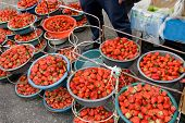 Large Ripe Red Strawberries In Large Cups At Grocery Market In Yerevan, Armenia poster