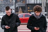 Young People Walking On Street Over Mall Concentrated On Technology Spending Time Online, Two Teenag poster