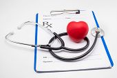 Red Heart Medical Stethoscope And Black Pen Put On The Doctors Charging Plate.health Examination Co poster