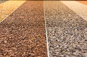 Close Up Of A Natural Stone Carpet. Decorative Stone Coating. Slip Resistant Floor Finish Containing poster