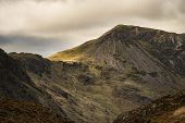 Majestic Autumn Fall Landscape Image Of Mountain Peaks In Lake District Near Buttermere With Gorgeou poster