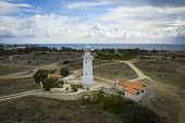 Old Lighthouse On Mediterranean Sea Shore In Paphos, Cyprus, Aerial View From Drone. Famous Place In poster