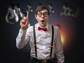 Nerd Genius Have An Idea. Funny Man With Raised Finger. poster