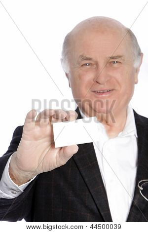 Smiling Senior Businessman Presenting His Card
