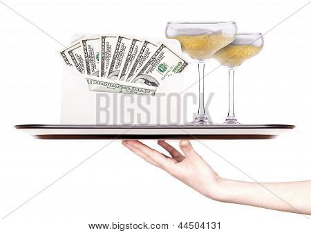 Money In Envelope On A Tray With Champagne And Hand