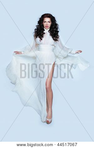 Young Beautiful Caucasian Brunette Woman In Gorgeous Dress, Motion Shot