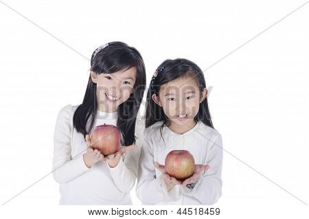 Cute children holds an apples over white background