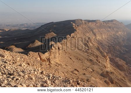 Rim of desert canyon at sunset (Small Crater or Makhtesh Katan Negev desert Israel)