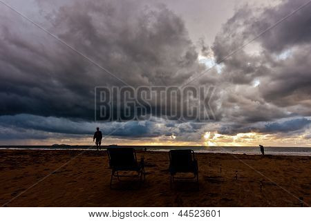 Storm clouds and sunset on the coast