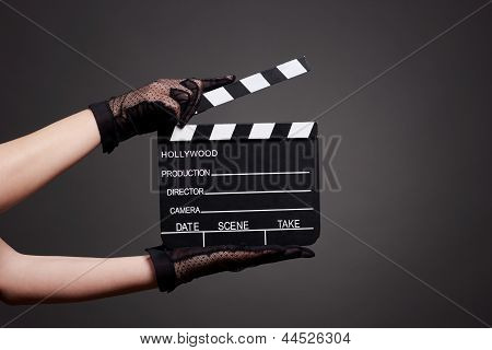 Woman hands holding a movie clapboard